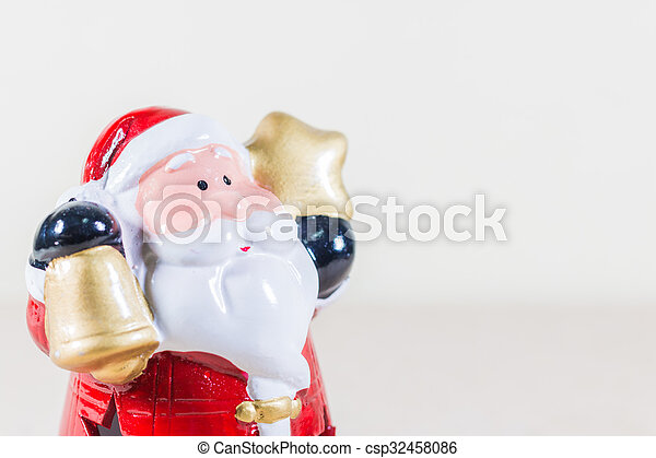 Santa Claus Holding Gold Star and Bell - csp32458086