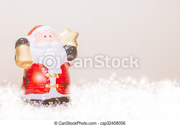 Santa Claus Holding Gold Star and Bell - csp32458056