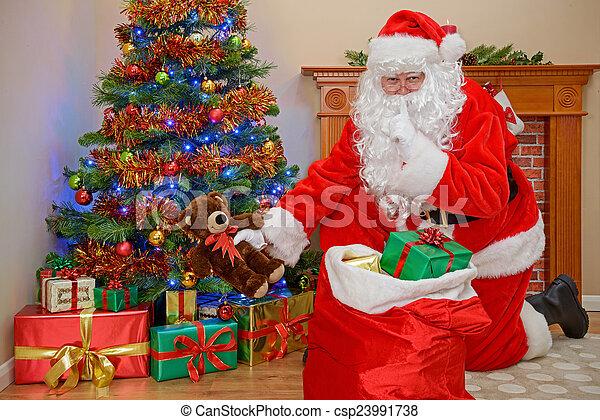santa delivering christmas presents csp23991738 - Santa Claus Presents