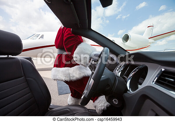 Santa Driving Convertible At Airport Terminal - csp16459943