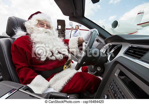 Santa Driving Convertible At Airport Terminal - csp16484420