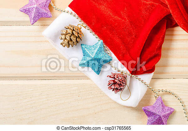 Santa Hat with Christmas decorations. - csp31765565