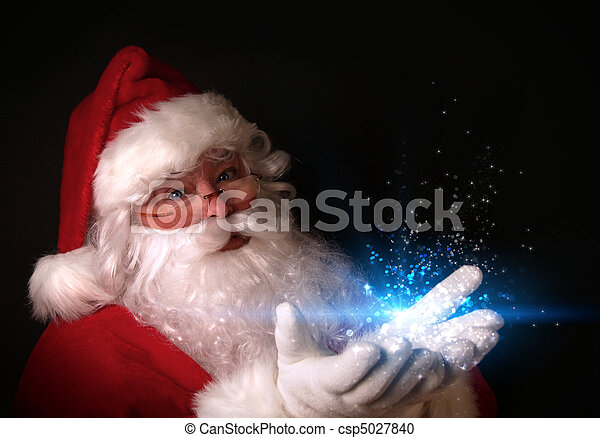 Santa holding magical lights in hands - csp5027840