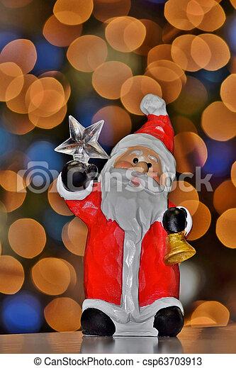 Santa ornament with bokeh lights. - csp63703913