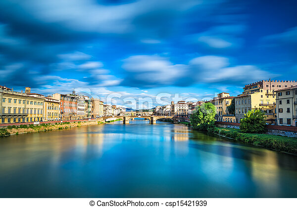 Santa Trinita and Old Bridge on Arno river, sunset landscape. Florence or Firenze, Italy. - csp15421939