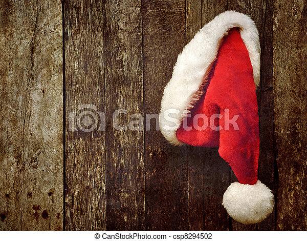 Santa's hat hanging on wood. - csp8294502