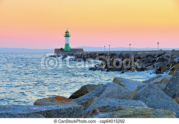 Sassnitz on island Ruegen, lighthouse in the evening - csp64015292