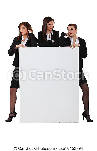 Sassy businesswomen with a board left blank for your message - csp10452794
