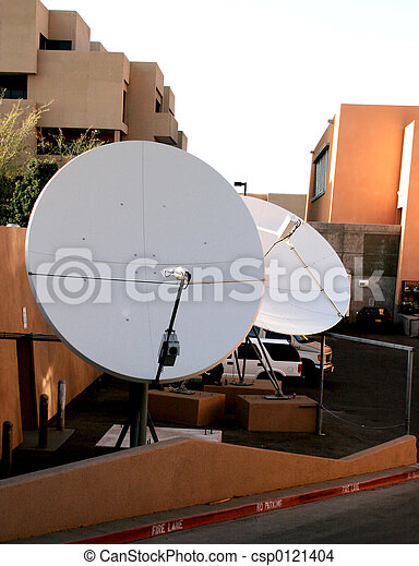 large old satellite dishes at a medical facility