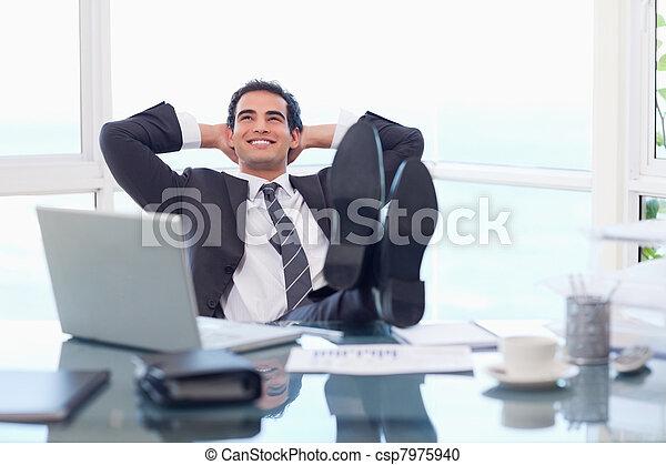 Satisfied businessman relaxing - csp7975940