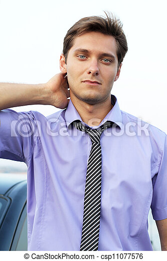 Satisfied smiling businessman in outdoors environment. - csp11077576