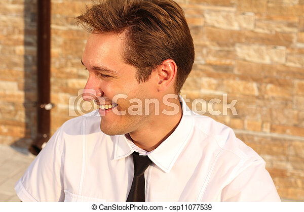 Satisfied smiling businessman, near house, outdoors - csp11077539