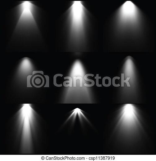 Schwarze und weiße Lichtquellen. Vector - csp11387919
