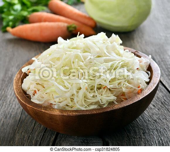 Sauerkraut in wooden bowl - csp31824805