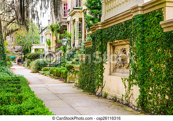 Savannah, Georgia, USA historic downtown sidewalks and rowhouses. - csp26116316