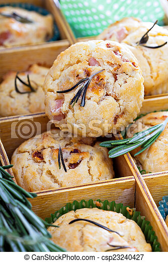 Savory muffins with herbs, tomatoes and ham - csp23240427