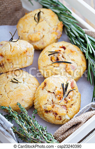 Savory muffins with herbs, tomatoes and ham - csp23240390