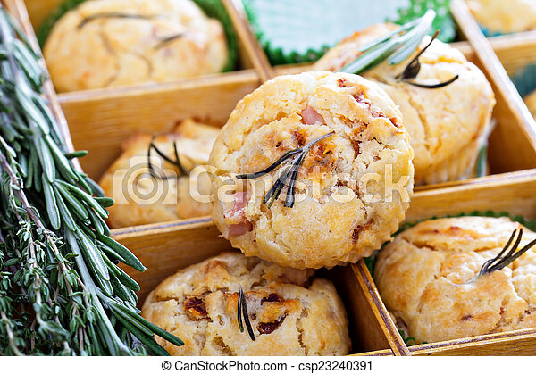 Savory muffins with herbs, tomatoes and ham - csp23240391