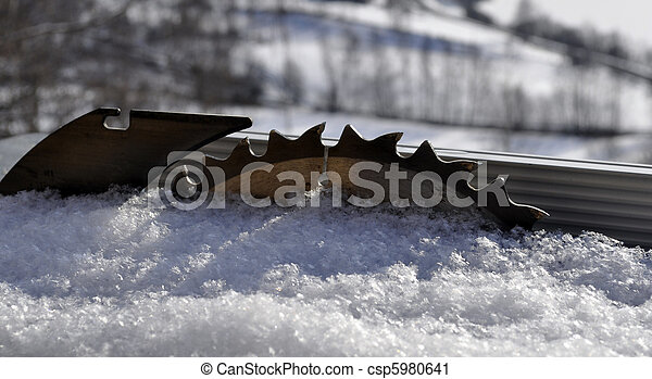 sawblade in the snow - csp5980641