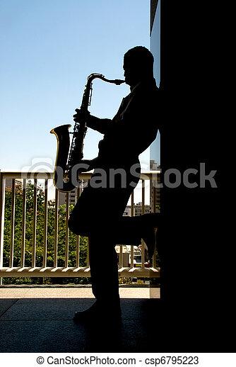 Saxophone player silhouette - csp6795223