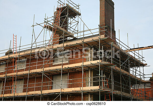 Scaffolding on Brick Building - csp0628610