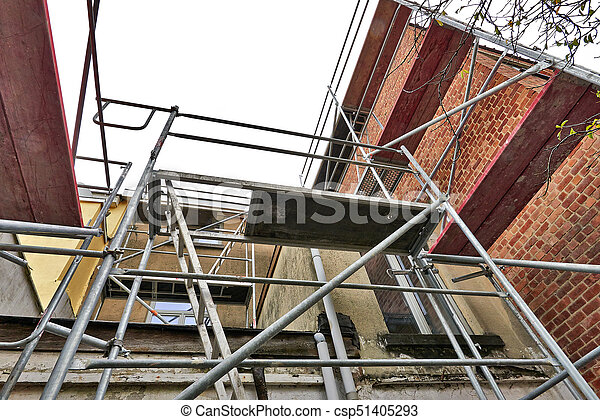 Scaffolding on terrace against dirty and grunge wall - csp51405293