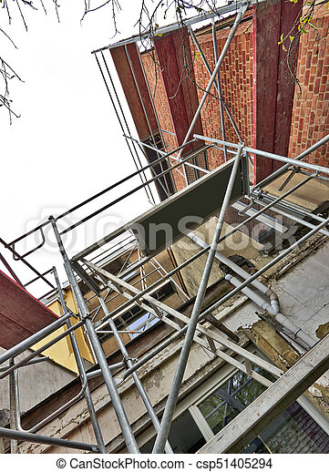 Scaffolding on terrace against dirty and grunge wall - csp51405294