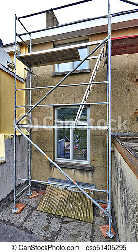 Scaffolding on terrace against dirty and grunge wall - csp51405295