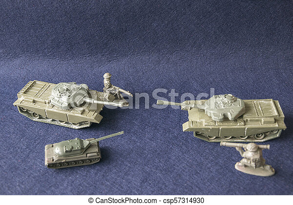 Scale models of toy plastic tanks and soldiers