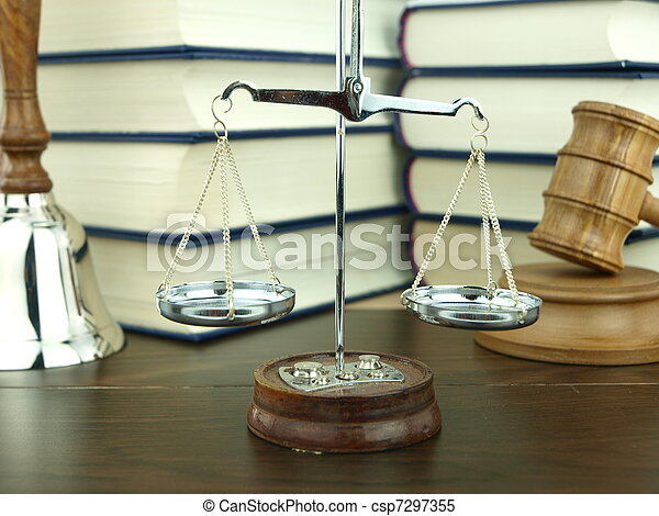 Scale of justice, hand bell and judge?s gavel with a stack of legal books background  - csp7297355