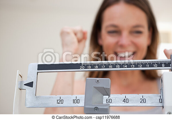 Scale showing weight loss - csp11976688