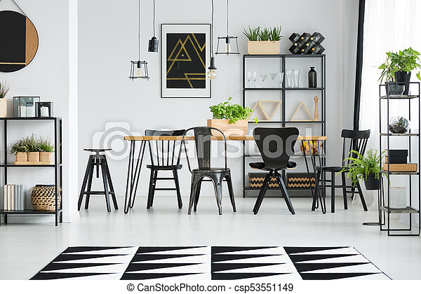 Scandinavian Style Dining Room Black Different Chairs At Table In Scandinavian Style Dining Room With Geometric Carpet And Canstock
