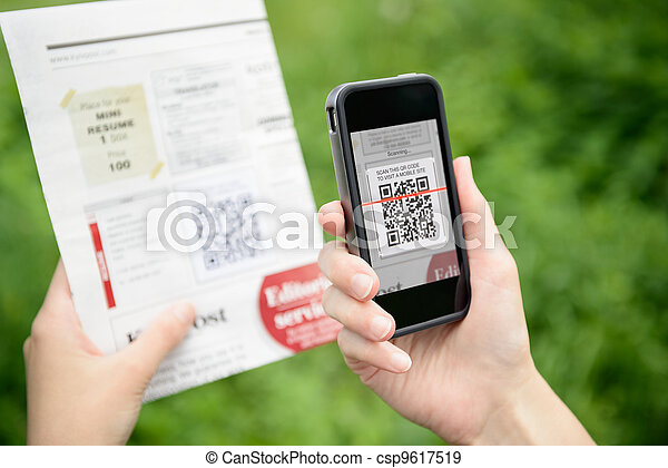 Scanning advertising with QR code on mobile phone - csp9617519