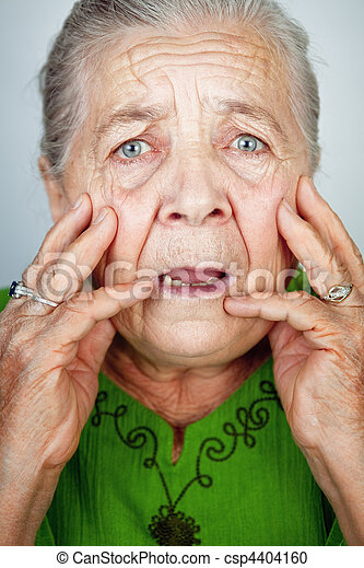 Scared and worried senior woman with wrinkles - csp4404160
