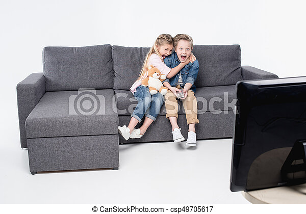 Cool Scared Boy And Girl Sitting On Sofa And Watching Tv Together Isolated On White Squirreltailoven Fun Painted Chair Ideas Images Squirreltailovenorg