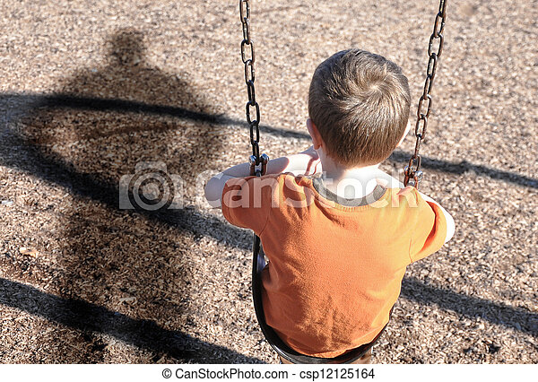 Scared Boy on Swingset with Bully Defense - csp12125164