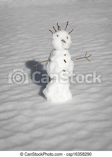 Scary small aggressive snowman in a winter forest - csp16358290