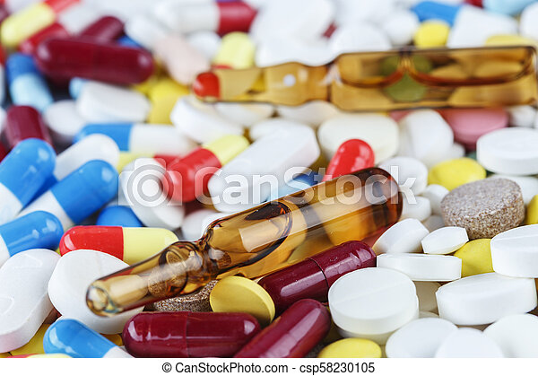 scattered multicolored tablets and ampoules - csp58230105