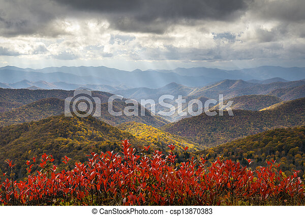 Scenic Autumn Blue Ridge Parkway Fall Foliage Crepuscular Light Rays travel and vacation destination - csp13870383