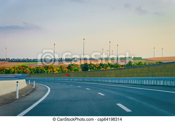 Scenic landscape with road in Slovenia wind mill - csp64198314