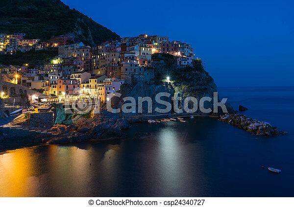 Scenic night view of colorful village Manarola in Cinque Terre,  - csp24340727