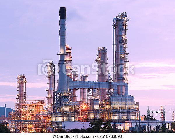 scenic of petrochemical oil refinery plant shines at night, closeup - csp10763090