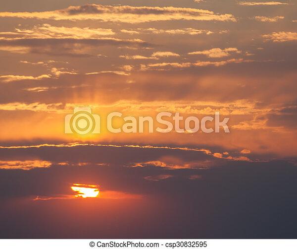Scenic orange sunset sky background - csp30832595