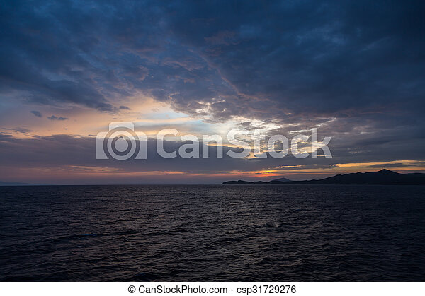 Scenic view of a beautiful sunset over the sea - csp31729276