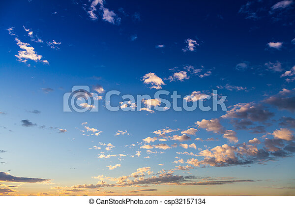 Scenic view of a beautiful sunset with blue sky and clouds - csp32157134