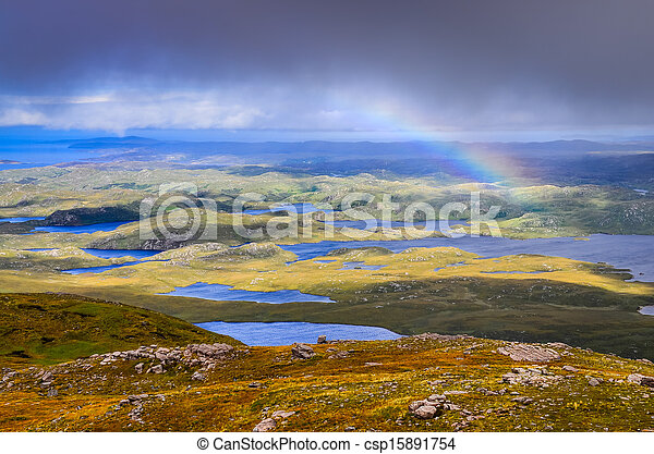 Scenic view of beautiful lakes, clouds and rainbow in Inverpolly area, highlands of Scotland, United Kingdom - csp15891754