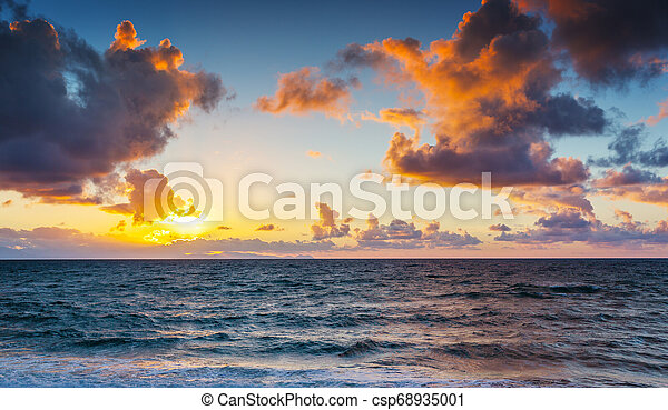Scenic view of beautiful sunset above the sea - csp68935001