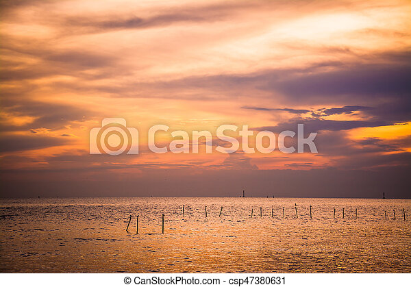 Scenic view of beautiful sunset above the sea - csp47380631