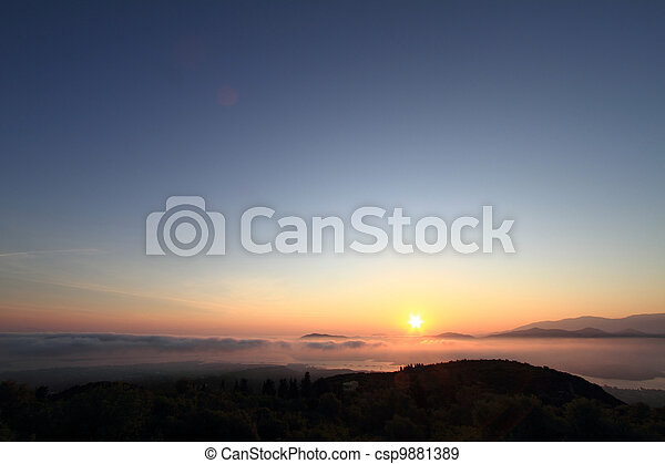 Scenic view of beautiful sunset over the mountains - csp9881389
