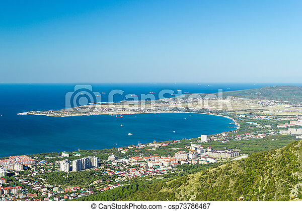 Scenic view of Gelendzhik city district and sea bay. Sunny day. Vacation on resort. - csp73786467
